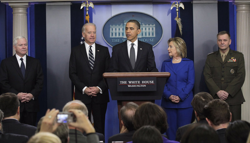 President Obama talks about the Afghanistan-Pakisan Annual Review during a briefing in the Brady Press Briefing room in the White House Thursday. From left are Defense Secretary Robert Gates, Vice President Joe Biden, the president, Secretary of State Hillary Rodham Clinton, and Joint Chiefs Vice Chairman Gen. James Cartwright. A five-page summary of the 40-page review says al-Qaida has metastasized outside the region.