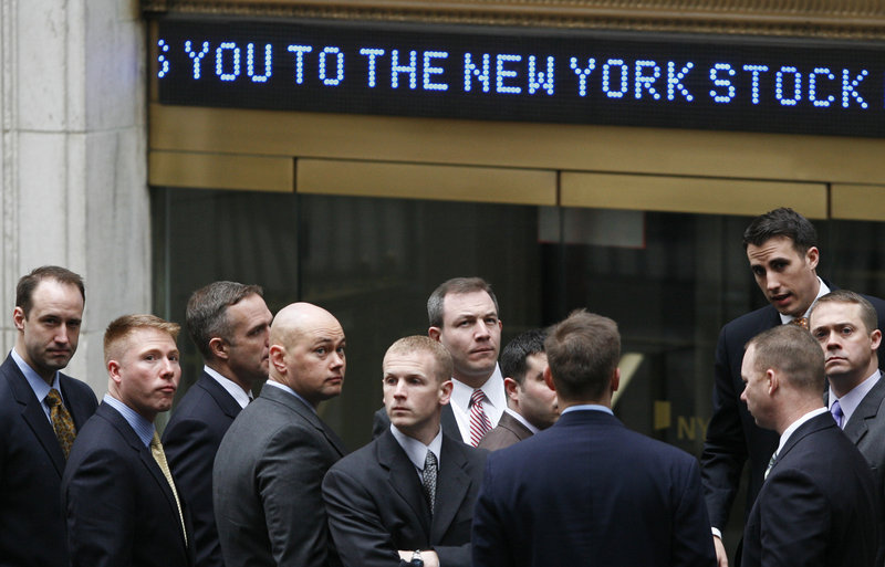2009 Associated Press file This is a two-lin In this March 9, 2009 file photo, businessmen arrive at the New York Stock Exchange. Fear and panic enveloped the stock market and the Dow Jones industrial average plunged to 6,547 on March 9. Many investors thought it would take a decade or longer to get back to the record of 14,165, set on Oct. 9, 2007. Now we could be on the verge.