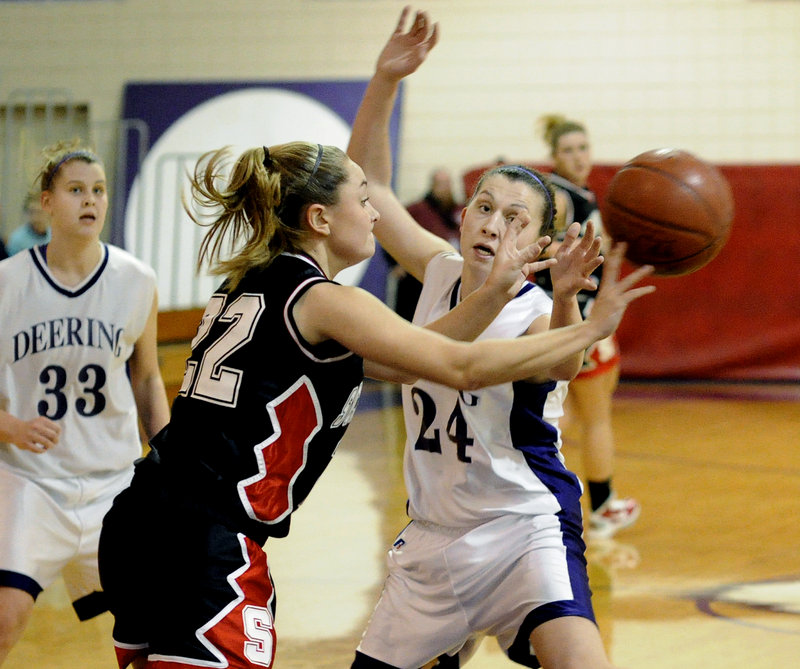 Emily Howes of Scarborough gets away a pass despite pressure from Deering's Ella Ramonas during a game Friday night at Deering High. The Rams took control early and improved to 3-0 with a 68-33 victory.