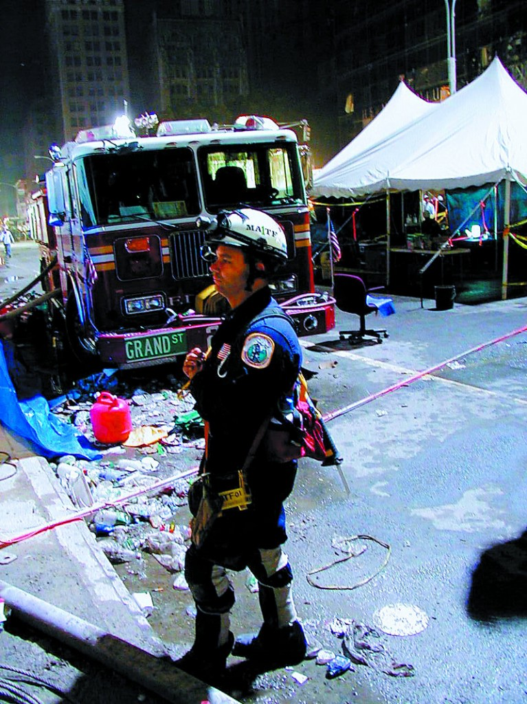 Capt. Mike Clarke of the Bath Fire Department works at New York's ground zero in this 2001 FEMA photo. A newly elected state representative, he is pushing for extra federal funding for 9/11 responders' health care.