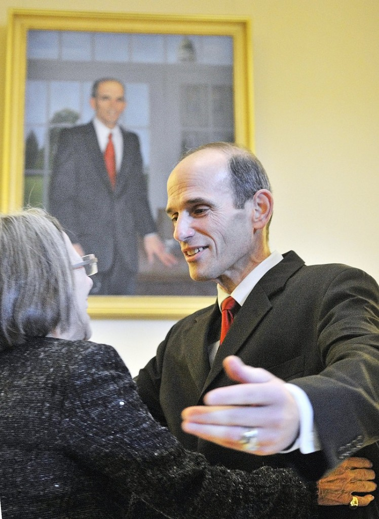 Artist Jean Pilk, left, gets a hug from Gov. John Baldacci after her portrait of him was unveiled during ceremonies in the State House on Saturday afternoon in Augusta. The oil painting is the 141st work of art to be hung permanently in the state Capitol, according to the officials at the Maine State Museum.