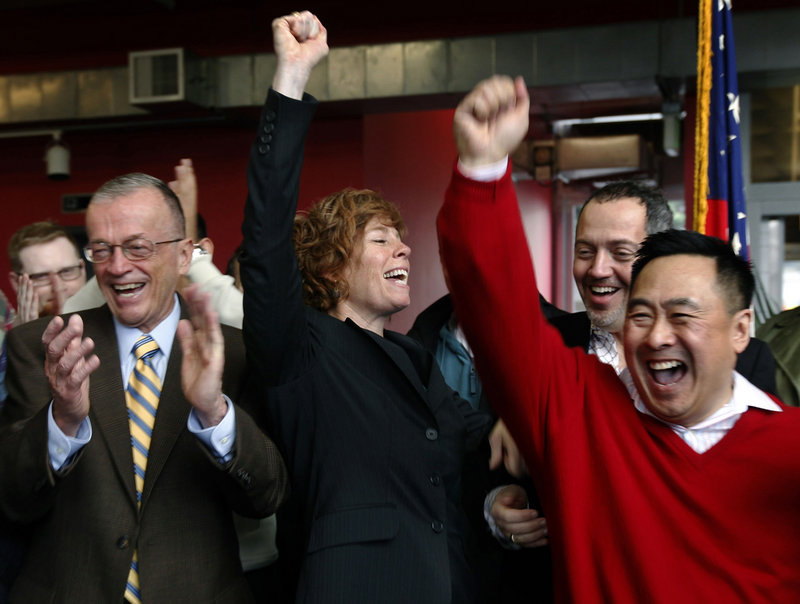 Zoe Dunning, center, a retired Navy commander, celebrates the vote by the U.S. Senate at the LGBT Center in San Francisco, Calif. on Saturday, as lawmakers agreed to do away with the military's 17-year ban on openly gay troops.