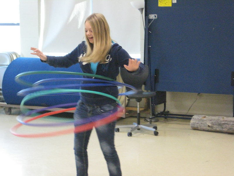 Eighth-grader Anna Perkins displays her skill with Hula Hoops, and as a result helps raise more than $1,300 for an orphanage in India.
