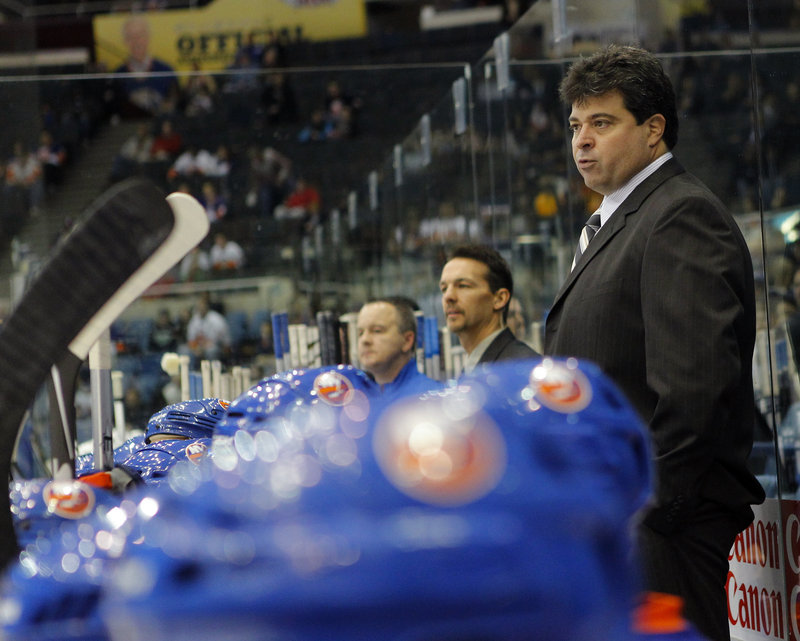 Jack Capuano, an All-America defenseman at the University of Maine, is in his second month as interim head coach of the New York Islanders after spending four seasons leading the Bridgeport Sound Tigers of the AHL.