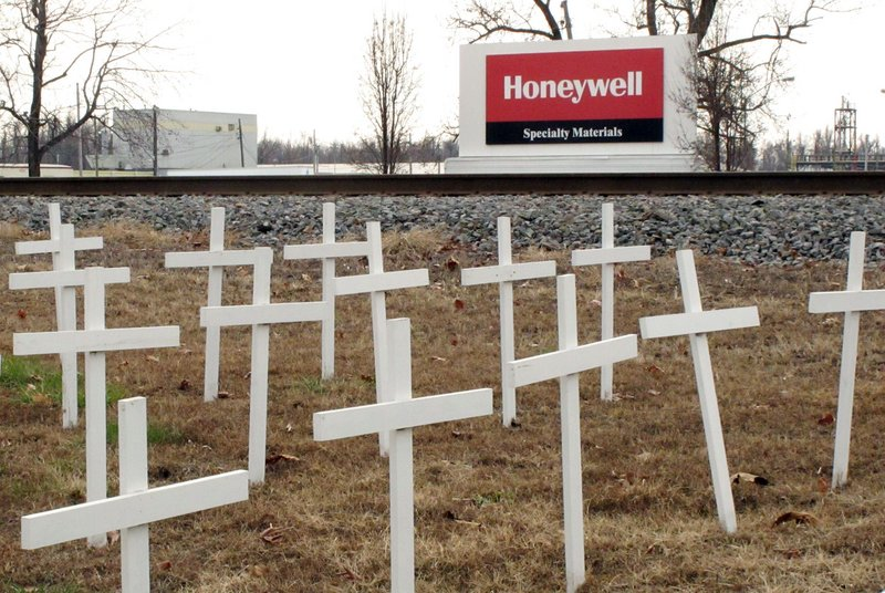 White crosses set up by locked-out union workers outside a Honeywell uranium conversion plant in Metropolis, Ill., represent former workers the union says died of cancer.