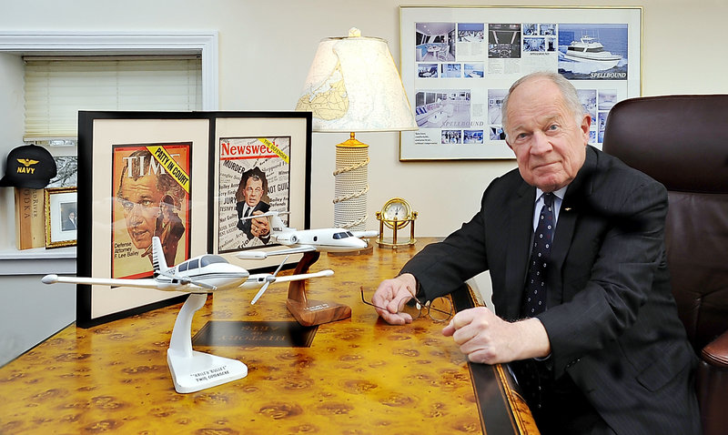 At his desk in Yarmouth, F. Lee Bailey is surrounded by evidence of a life in the spotlight, including covers of Time and Newsweek magazines relating to famous trials, and of his passions, aircraft and yachts.