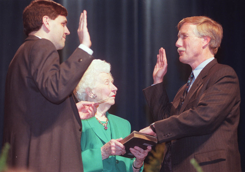 Mark Lawrence, left, then president of the Maine Senate, administers the oath of office to Gov. Angus King for his second term on Jan. 7, 1999, as King's mother holds the Bible. King's Web page called him the 71st governor, even though the state register listed him as No. 72.