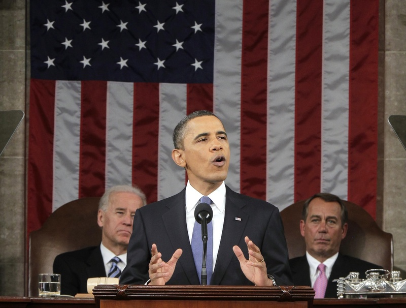 """President Obama delivers his State of the Union address Tuesday night in the House chamber, saying """"this is our generation's Sputnik moment"""" for meeting a challenge. Behind him are Vice President Joe Biden, left, and House Speaker John Boehner, R-Ohio."""