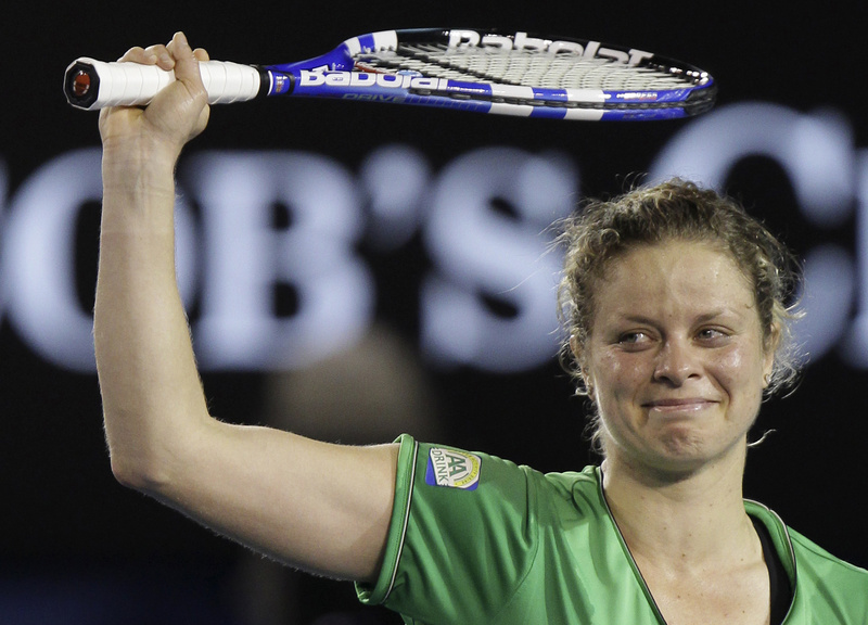 Kim Clijsters raises her arms as she celebrates her win over China's Li Na in the women's singles final at the Australian Open today.