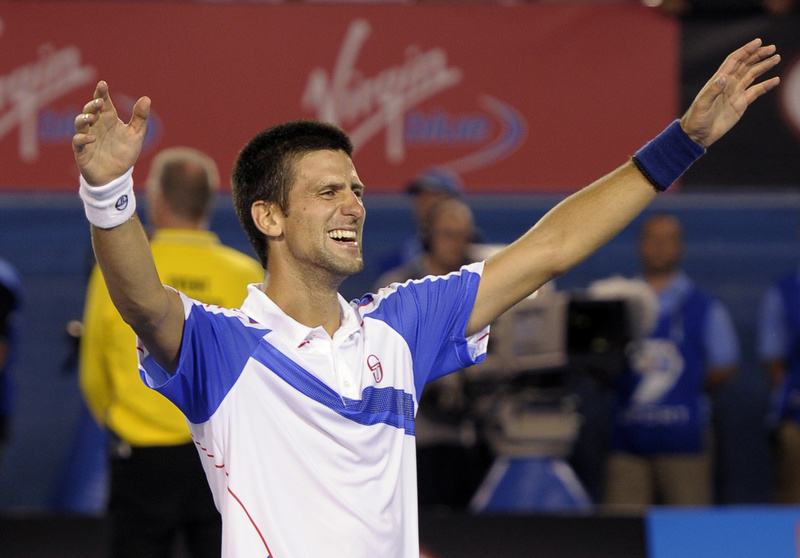 Novak Djokovic celebrates after beating Andy Murray in men's singles final at the Australian Open today. Djokovic won in straight sets.