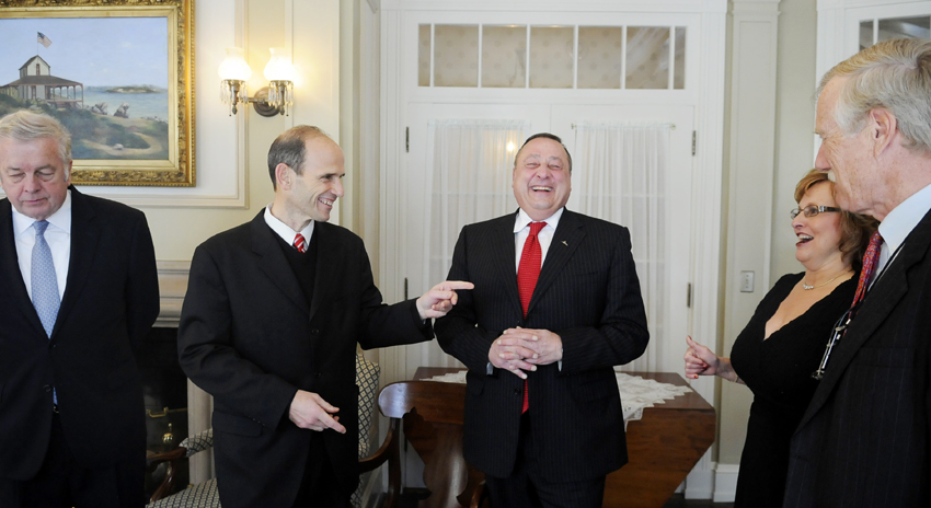 Governors Joe Brennan, left; John Baldacci, second from left; and Angus King, right, speak with Gov.-elect Paul LePage and his wife, Ann, during a reception at the Blaine House this morning.