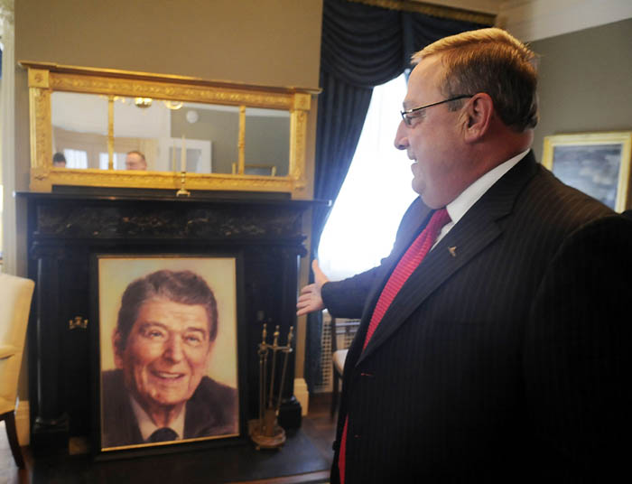 Paul LePage admires a portrait of Ronald Reagan in the Blaine House this morning.