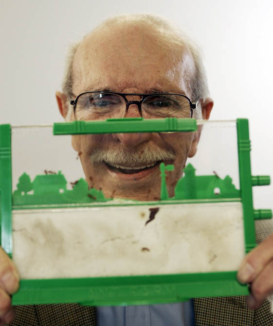 In this 2006 photo, Milton Levine, co-inventor of the classic Ant Farm educational toy, poses with his invention.