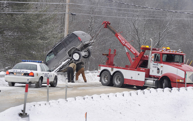 Route 114 in Gorham was closed temporarily this morning as a wrecker removed this 1997 Chevrolet Tahoe.