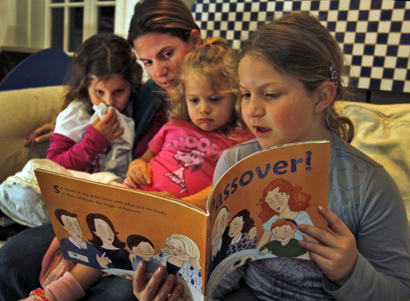 Sharon Litwak and her children Andrea, 7, left, Jessica, 5, right, and Ilana, 2, read Jewish books at home in Tarzana, Calif. At a time when the Jewish identity is at risk of being diluted, Litwak said it helps â to bring new ideas into the house, like new ideas of what you can do during Shabbat.â 01000000 12000000 ACE krtcampus campus krtentertainment entertainment krtfeatures features krtnational national krtreligion religion REL krtedonly mct 01010000 krtculture culture krtliterature literature 12011000 krtjudaism judaism jewish jew krtdiversity diversity woman women youth 2011 krt2011