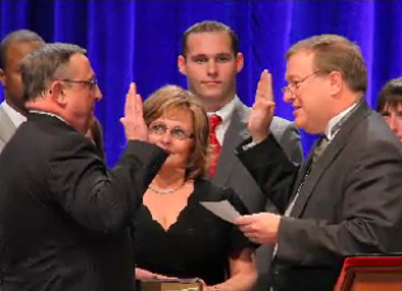 Paul LePage, left, is sworn in as Maine's new governor by Senate President Kevin Raye. R-Perry.