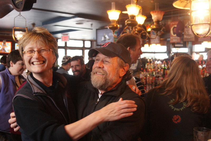 Anita Sebastian of Sherborn, Mass., hugs Steve Pierce, a Carrabassett Valley selectman, at the Bag & Kettle Brew Pub at the base of Sugarloaf.