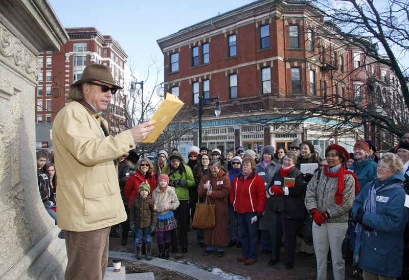 "Portland's poet laureate Steve Luttrell reads one of his works, ""Machigonne,"" at Longfellow Square."
