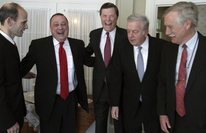 Paul LePage shares a laugh with four former Maine governors at the Blaine House before heading to his swearing-in ceremony Wednesday at the Augusta Civic Center. From left are John Baldacci, LePage, John McKernan, Joseph Brennan and Angus King.