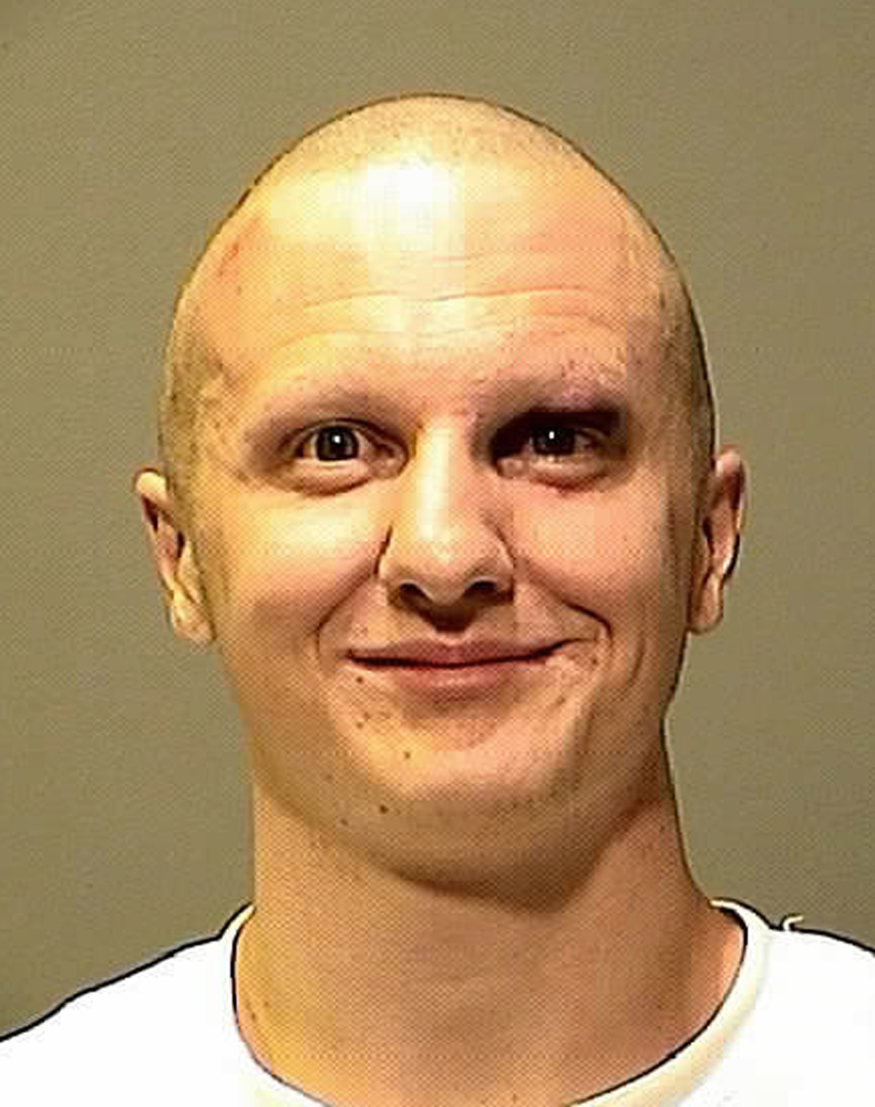Shooting suspect Jared Loughner smiles in a photo provided by the Pima County, Arizona, Sheriff's Department.