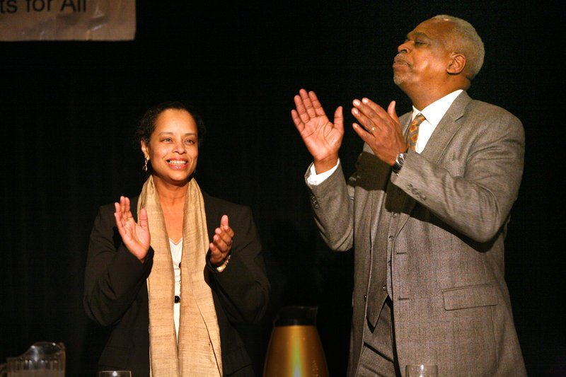 "Rachel Talbot Ross, state director of the NAACP and president of the Portland branch, and keynote speaker Wade Henderson sing ""We Shall Overcome"" with the crowd at the 30th annual Martin Luther King Jr. celebration dinner Sunday."
