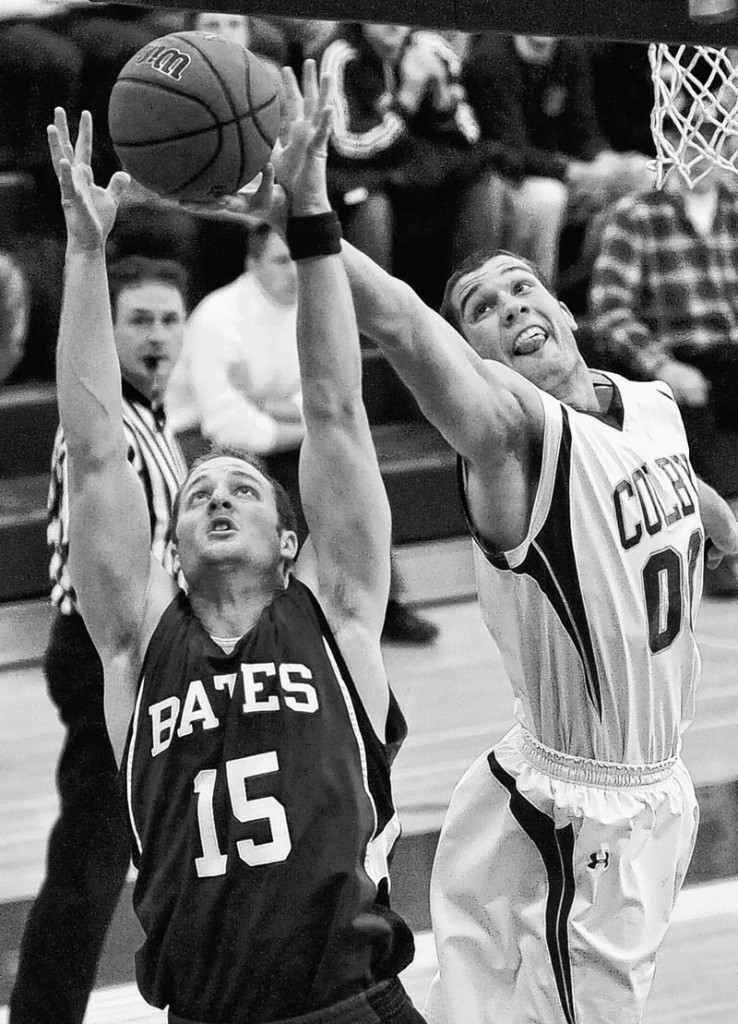 Alex Gallant of Bates battles for the rebound with Colby's Mike Russell during Friday night's game at Waterville. Colby tied the game with three seconds left in regulation, then won 75-69 in overtime.