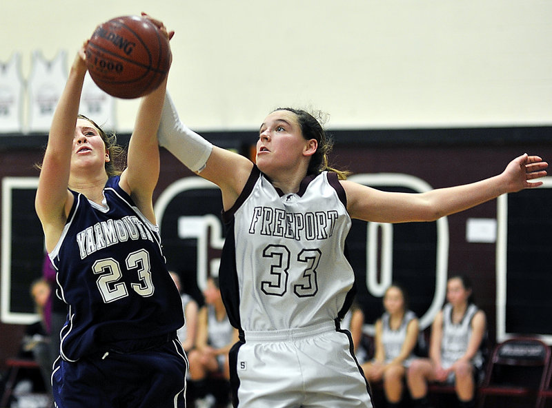 Sean Cahill, left, of Yarmouth competes with Aubrey Pennell of Freeport for a rebound Friday in the first half of Freeport's 42-31 victory in a Western Maine Conference game at home.