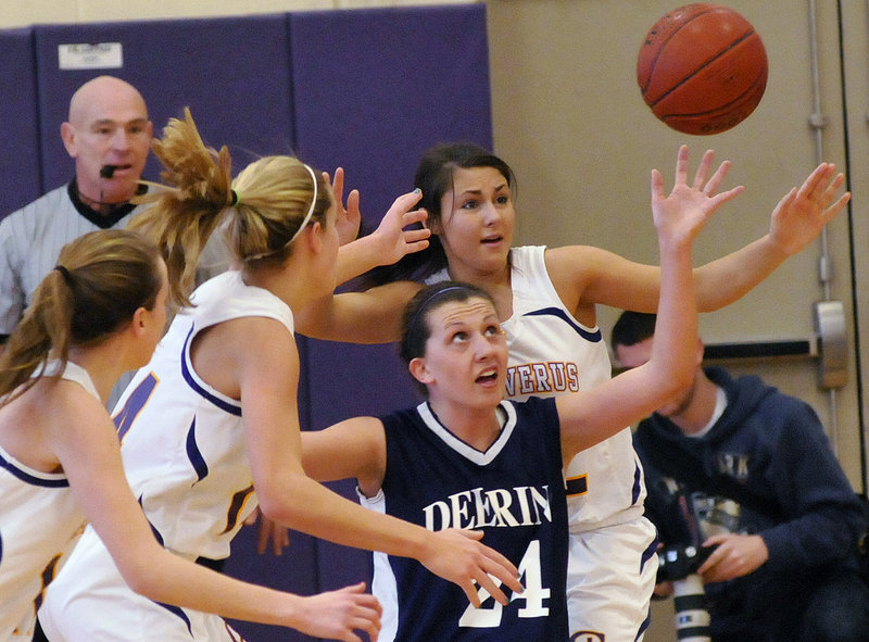 Ella Ramonas of Deering has her eyes on a loose ball while surrounded by Cheverus defenders, including Alexandra Palazzi-Leahy, right.
