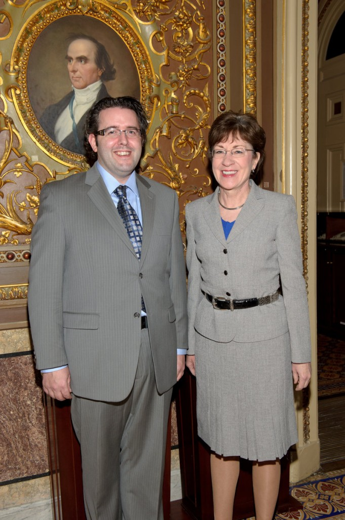 Shawn Towle, a Falmouth Middle School teacher who received a Presidential Award for Excellence in Mathematics and Science teaching, poses with Sen. Susan Collins.