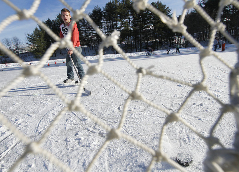 Justin Ouellette, 16, of Biddeford shoots a puck Saturday at West Brook Ice Rink on Pool Street in Biddeford. Efforts are under way to address a serious erosion problem.