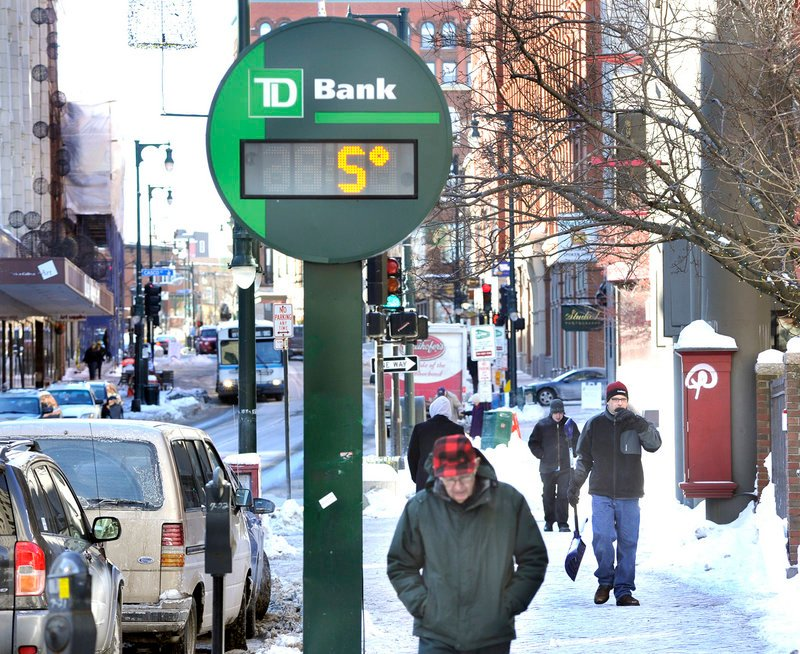 Pedestrians brave the 5-degree weather Monday along Congress Street in Portland. Warmer air arriving from the west may boost today s readings into the upper 20s in Greater Portland.