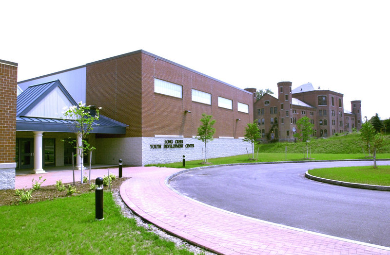 The Long Creek Youth Development Center, left, shown after construction in July 2002. At right is the main building of the former Maine Youth Center.