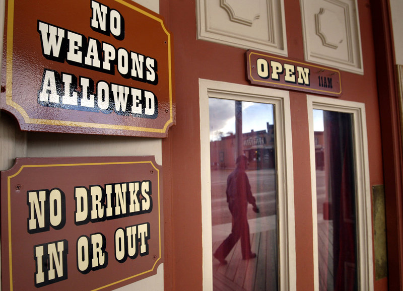 Signs provide reminders for patrons of establishments in downtown Tombstone, Ariz. Tombstone, southeast of Tucson, has had a colorful past, and is perhaps best known for the famous Gunfight at the O.K. Corral on Oct. 26, 1881 that left three men dead. Tombstone was originally founded as a silver mining town.