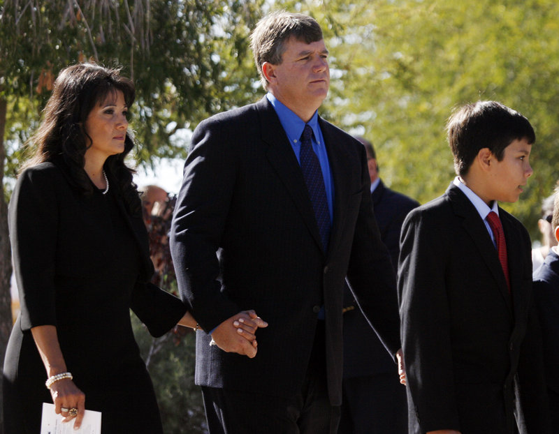 Roxanna and John Green arrive at a Tucson church Jan. 13 for the funeral of their 9-year-old daughter, Christina Taylor Green. With them is their son, Dallas.