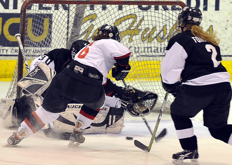 Abby Rutt of Scarborough moves the puck to her backhand before sliding it past St. Dom's goalie Nicole Keaney during Monday's game at USM Arena. Rutt's goal tied the game at 2 late in the second period, but St. Dom's eventually pulled out a 3-2 victory.
