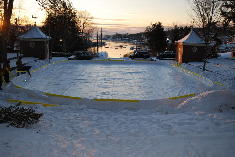 With the boards up and the liner in place, the rink beside Camden Harbor stands ready earlier this month to be filled with water.
