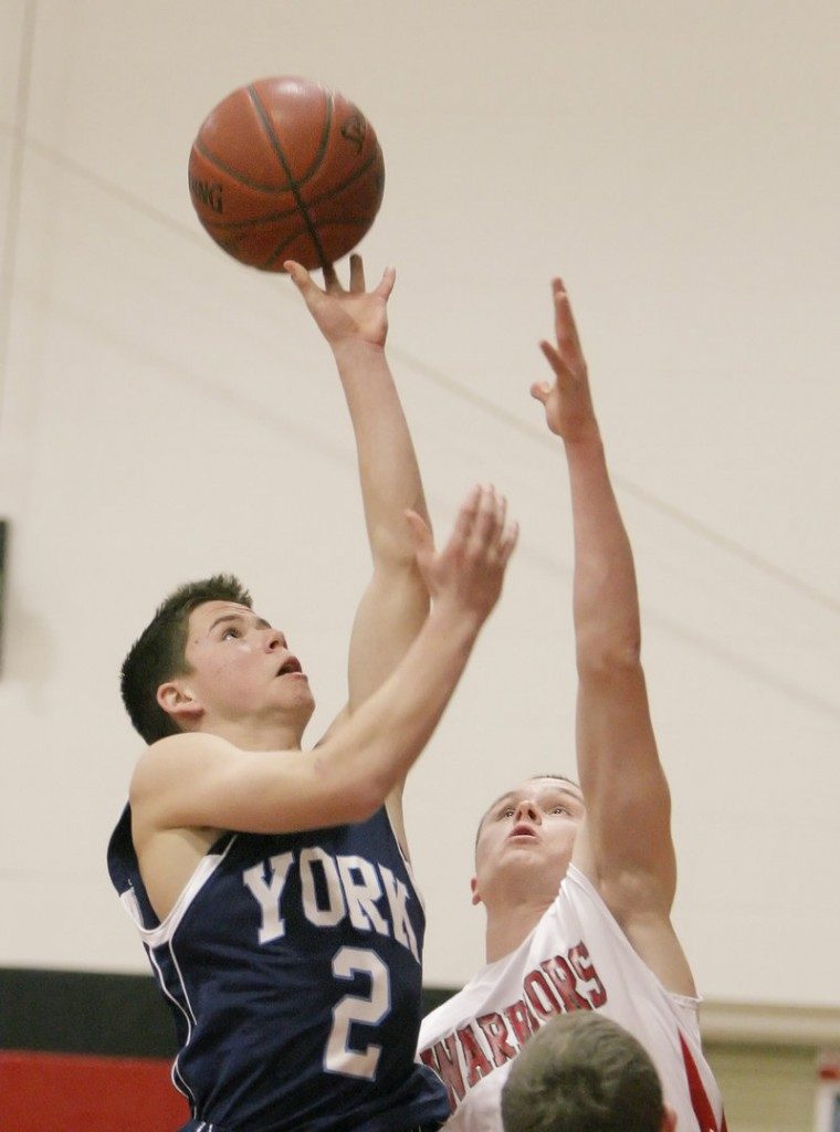 Thomas Kinton, who scored 10 points for York, puts up a shot Tuesday as Paul McDonough of Wells defends during York's 50-31 victory at Wells High.
