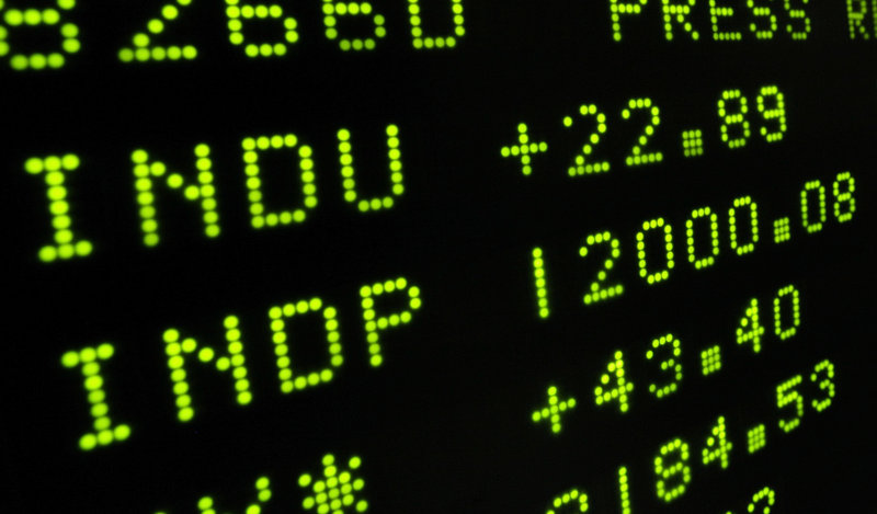 A board at the New York Stock Exchange shows the Dow Jones Industrial Average as it crosses the 12,000 mark during trading on Wednesday. The index reached 12,020 before fading.