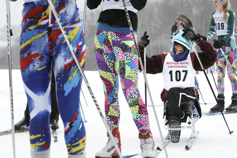 Christina Kouros adjusts her hat while waiting in a starting line at a Nordic ski competition at Pineland Farms in New Gloucester on Wednesday. Kouros, a Cape Elizabeth High School sophomore, competes on the team using a sit-ski.