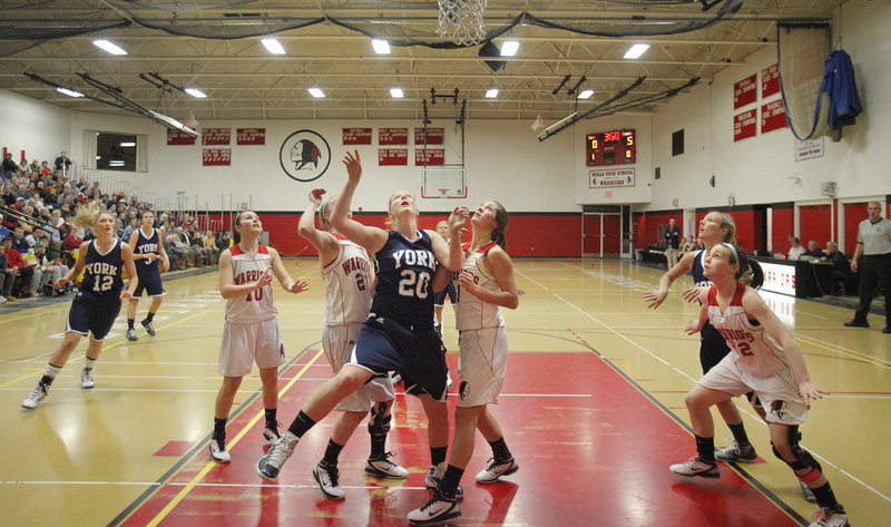 Returning starters Emily Campbell, No. 12, Nicole Taylor, No. 20, and Stephanie Gallagher, right, made it clear that York's goal for this season was to repeat as Class B state champions. The Wildcats seem solidly on course as they steamroll through their regular-season schedule.