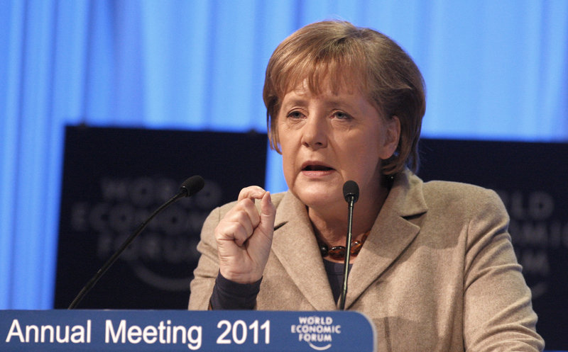 Both German Chancellor Angela Merkel, above, and British Prime Minister David Cameron warned Friday that failure to conclude the so-called Doha round of trade talks risks setting back efforts to liberalize global commerce by years, if not decades.