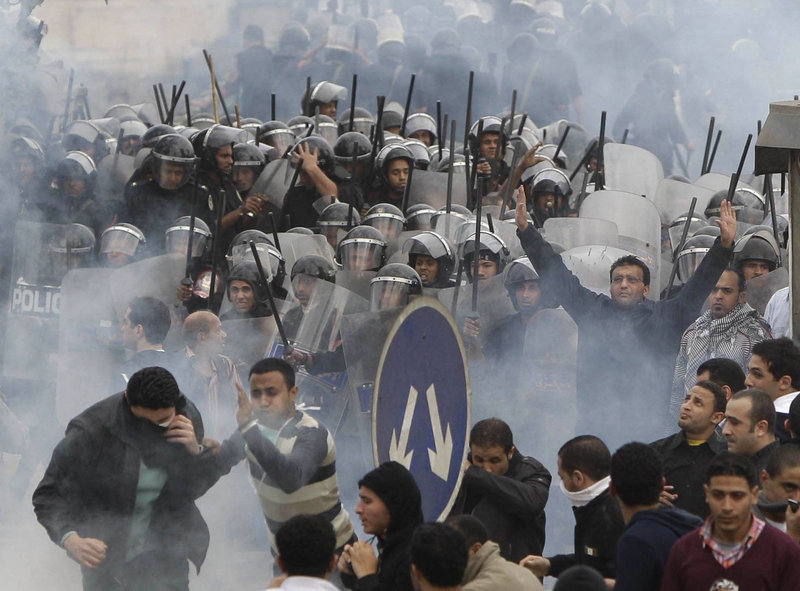 Demonstrators clash with riot police in Cairo on Friday. Tens of thousands of protesters confronted police who fired back with rubber bullets and tear gas in the most violent scenes yet in the challenge to President Hosni Mubarak's 30-year rule.