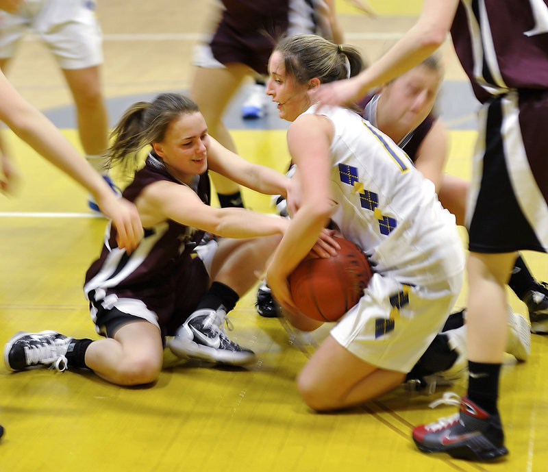 Megan Coale, left, of Greely and Falmouth's Jackie Doyle battle for a loose ball in the middle of a scrum. The Rangers improved to 11-2 with a 41-34 victory.