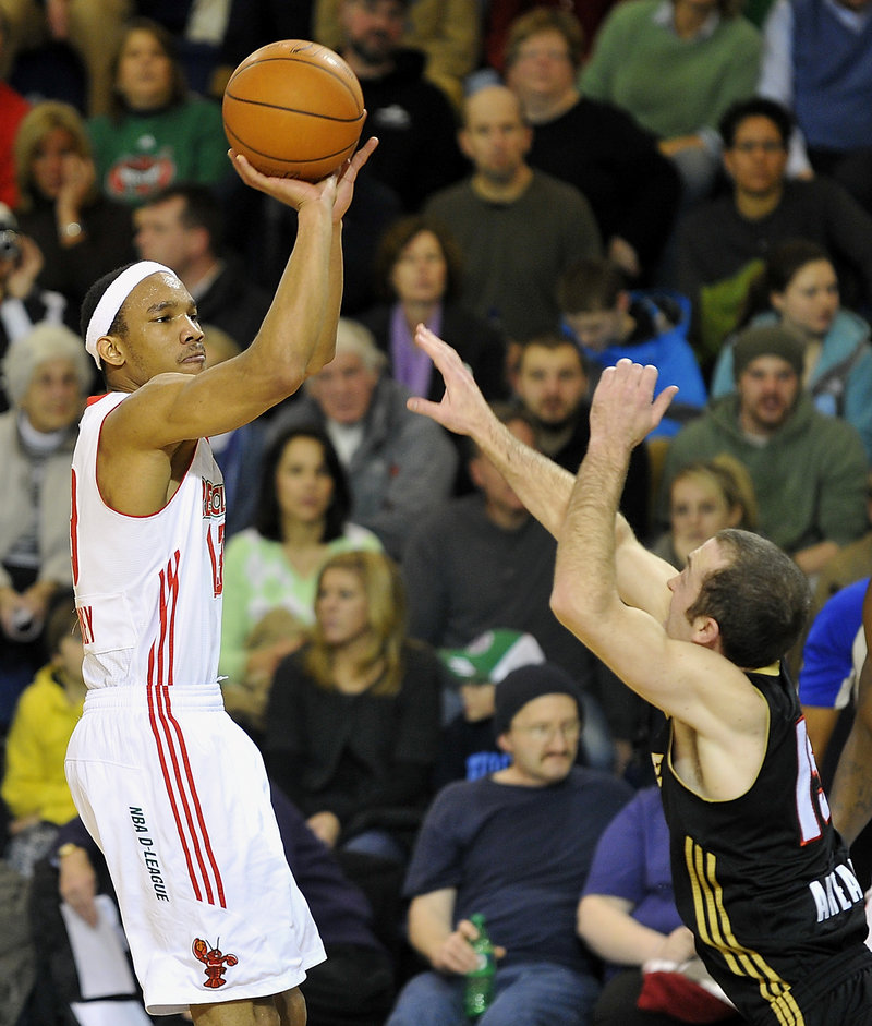 Maine's Avery Bradley goes up for a 3-pointer against Erie's Blake Ahearn in the second half Friday night at the Portland Expo. The Red Claws lost, 113-109.