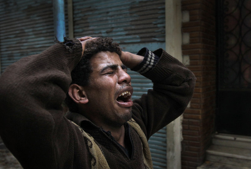 A protester in Tahrir Square cries out Saturday after seeing the body of another who was shot by police moments earlier.