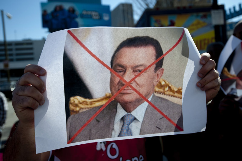 An Egyptian-American, who gathered with several hundred other protesters in Atlanta on Saturday, shows his displeasure with Egyptian President Hosni Mubarak.