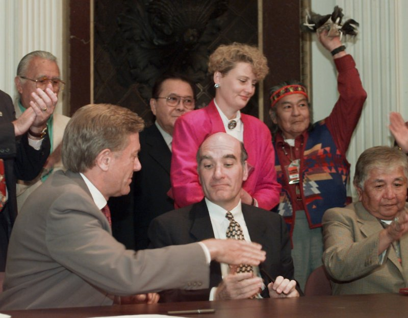 """Bruce Babbitt, left, the Interior secretary at the time, reaches to shake hands with then-Commerce Secretary William Daley after signing an agreement in June 1997 in which Indian tribes would protect fish and wildlife on their own lands. Daley, now President Obama's chief of staff, once observed that because the Commerce Department oversees the National Oceanic and Atmospheric Administration, the commerce secretary """"spent 60 percent of his time dealing with fish."""" Proposals are afoot to streamline the department."""
