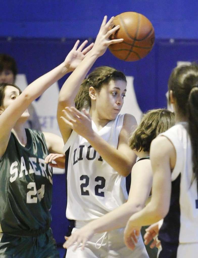 Suzie Gonzalez of Greater Portland Christian finds a teammate Saturday while pressured by Brittany Troxell of Calvary Chapel. Greater Portland Christian won, 50-32.