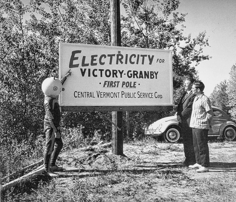 A sign is displayed during rural electrification in this photo provided by Central Vermont Public Service. In northern Vermont, it took until the 1960s to run power lines to some towns. These days, rural residents await broadband Internet access.