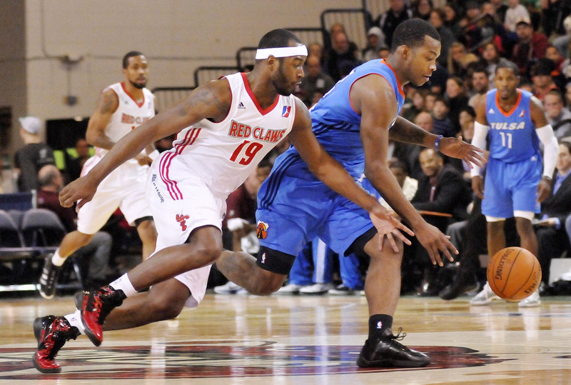 Maine's Mario West, left, tries to steal the ball Sunday in the Red Claws' 109-106 win over Tulsa. The Red Claws came up with 20 steals, including a league record-tying nine by Avery Bradley.